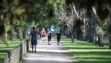 Park rangers patrol Melbourne's green spaces.