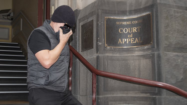 David Hingst covers his face as he leaves the Court of Appeal in Melbourne on Friday.