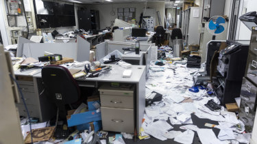 Paper and damaged furnishings sit in the security control room during a media tour of the Legislative Council building in Hong Kong.
