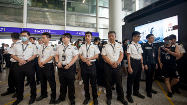 Airport security staff stand guard at the Hong Kong International Airport on Wednesday evening.