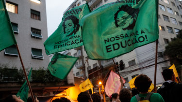 Thousands of demonstrators marched in Brazil's major cities on Wednesday to protest the government's cuts to education.
