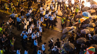 Demonstrators clash with police on Canton Road during a protest in the Tsim Sha Tsui district of Hong Kong on Sunday.