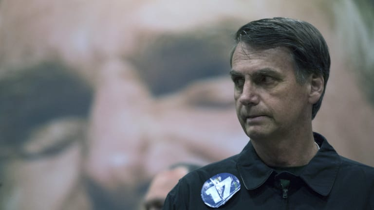 Presidential candidate Jair Bolsonaro has urged his supporters to avoid political violence.