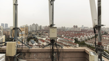 Huawei signal-transmission equipment stands on a building rooftop in Shanghai. China's largest technology company denies committing the alleged charges.