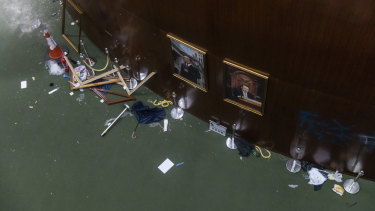 A broken politician portrait frame rests on the floor inside the Legislative Council building in Hong Kong.
