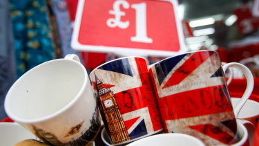 A souvenir shop for tourists displays mugs with Union Jacks. Britain's retail sector may be disrupted by a hard Brexit.