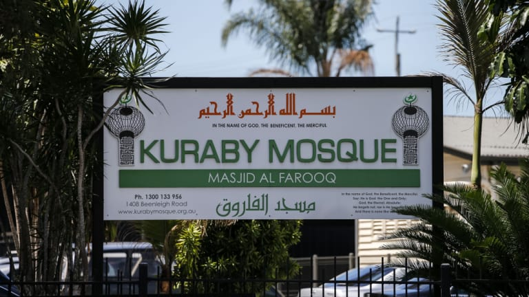 Local Islamic leaders say four men claiming to be with the media entered the Kuraby mosque asking to film inside, but then began hurling abuse and expletives at worshippers.