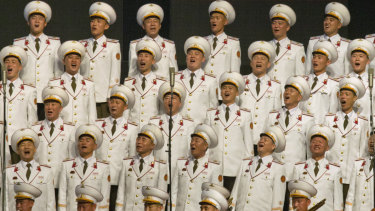 North Korean military choir members sing during an evening gala on Saturday.