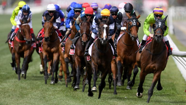Race leaders Cismonte (right), Boomtime (second right) and Gallante (centre) on the first lap of the 2017 Melbourne Cup.