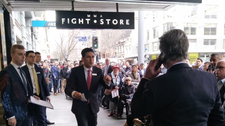 A large crowd watched auctioneer Paul Tzamalis sell 349 Elizabeth Street for $6.81 million.