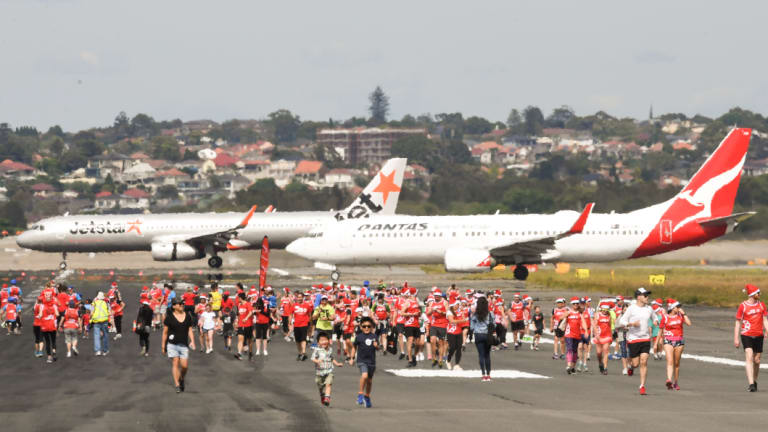 Runners took to a Sydney Airport runway on Sunday morning.