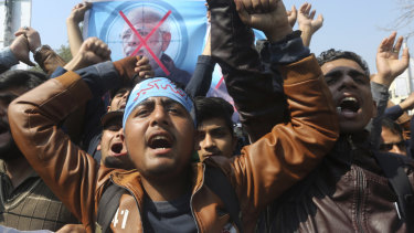 Supporters of Pakistani religious group Islami Jamiat-e-Talaba chant slogans at a rally against India on Wednesday February 27.
