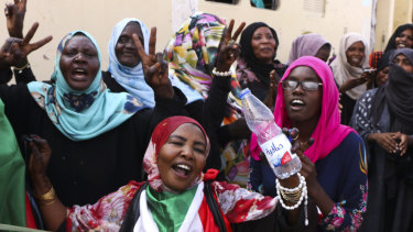 Sudanese pro-democracy supporters celebrate a final power-sharing agreement with the ruling military council on Saturday.
