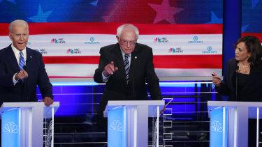 Joe Biden (left) often flailed. With Bernie Sanders and Kamala Harris.