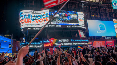 People celebrate as President-elect Joe Biden is declared the winner of the US presidential election.
