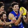 Live AFL: Bulldogs kick 21 consecutive goals in Dons thumping