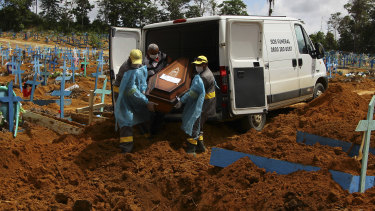 Cemetery workers carry the coffin of 89-year-old Abilio Ribeiro, who died of COVID-19, at a cemetery in Manaus, Brazil this month.