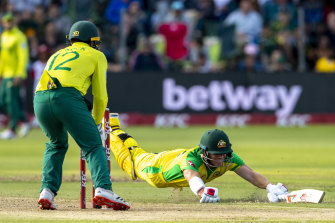 David Warner dives as he survives a run out attempt.