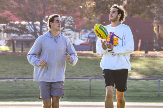 Twins and AFL players Ben (left) and Max King training together at a local park in Melbourne while the AFL is shut down.