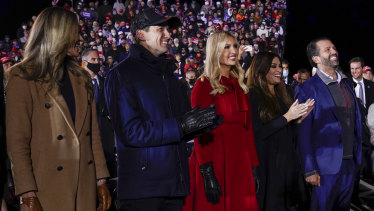 Lara Trump, Ivanka Trump and her husband Jared Kushner and Donald Trump Jr., and his girlfriend Kimberly Guilfoyle, listen to President Donald Trump speak.