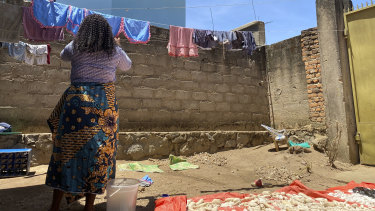 """Reby, outside her home in Beni, eastern Congo, says she was told: """"You are a big girl and if you sleep with me, you are going to be a high-ranking member of the Ebola response in Beni and you are going to receive around $US800 a month."""" She refused."""