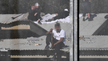 Detainees on the roof of the Frank Baxter Juvenile Justice Centre during a stand-off at the youth prison last week.
