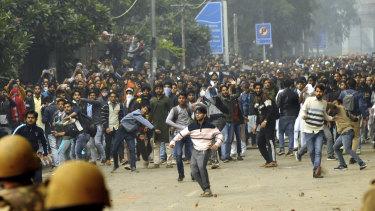 Students protest outside Jamia Millia Islamia University in Delhi.
