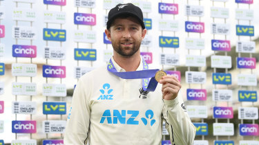 Devon Conway poses with his man of the match award after the first Test against England at Lord's.