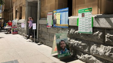 Instead of how-to-vote cards, candidates have had to improvise with large posters people can take photos of on their phone.