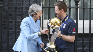 England captain Eoin Morgan shares a laugh with British PM Theresa May.