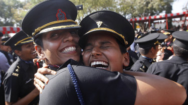 Women cadets celebrate after their graduation ceremony at the Indian Army's Officers Training Academy in Chennai, India.