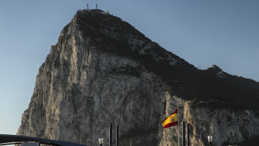 A Spanish flag flies on top of the customs house on the Spanish side of the border with the British overseas territory.
