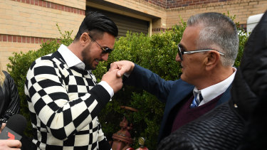 Salim Mehajer greets his father Mohamed Mehajer as he leaves court.