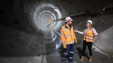 Transport Infrastructure minister Jacinta Allan talks to a tunneling worker underground, in the Metro Tunnel.
