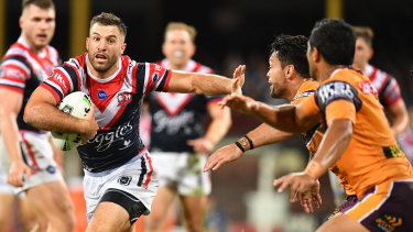 Brush-off: Roosters fullback James Tedesco turns on the afterburners against his old club.