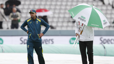 Nathan Lyon walks off the pitch after speaking to the 4th umpire Alex Wharf.