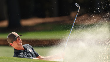 Scott plays a shot from a bunker on the 18th hole during a practice round at Augusta.