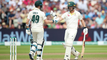 Partners in crime: Smith and Travis Head shared two very important partnerships in the first Test.
