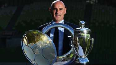 Club legend: Departing Melbourne Victory coach Kevin Muscat with some of his silverware at AAMI Park on Monday.