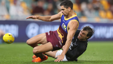 Charlie Cameron is tackled by Lachie Plowman.