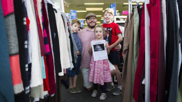 Igor Dopita, with his children Charlie Dopita, 7, Lyla Dopita, 4, and Lucas Dopita, 9, is offering a $500 reward for his great-grandfather's World War 1 helmet which was last seen at the Queanbeyan St Vincent de Paul store.