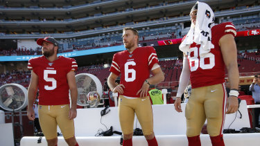 Mitch Wishnowsky, centre, from Perth is playing in the Super Bowl.