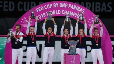 World beaters: Team France show off their silverware after winning the Fed Cup final in Perth.