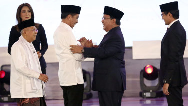 Indonesian President Joko Widodo, second left, with his running mate Ma'ruf Amin, left, and his contender Prabowo Subianto, second right, with his running mate Sandiaga Uno.