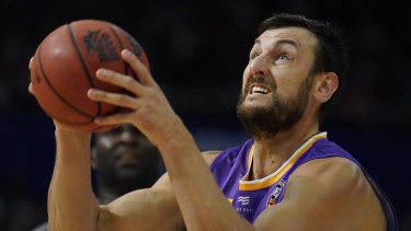 Andrew Bogut shoots for the basket during the victory over the Cairns Taipans at Qudos Bank Arena.