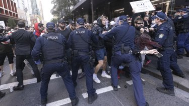 Police interact with demonstrators during an anti-lockdown protest in Sydney's CBD on July 24.