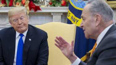 Senate Minority Leader Chuck Schumer, a Democrat from New York, right, speaks while US President Donald Trump listens during a meeting at the Oval Office of the White House in Washington, DC.