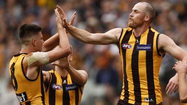 Jarryd Roughead (right) congratulates Mitchell Lewis after combining for a goal .