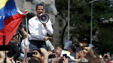 The leader of Venezuela's National Assembly Juan Guaido, who declared himself the country's interim president, speaks to supporters during a rally against the government of President Nicolas Maduro, in Caracas, Venezuela, on Saturday.