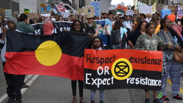 The march down William Street was led by Extinction Rebellion supporters, demanding justice for Ms Clarke.